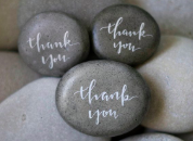 """Three stones with """"thank you"""" written on them"""